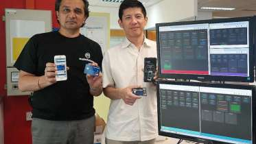 MatchMove Pay's CEO Shailesh Naik (left) and chief operating officer Hsueh Huah Leow with their firm's flagship innovation, the MatchMove virtual card, and its latest product, the MatchMove card, which is the physical version of the virtual card. PHOTO: MATCHMOVE