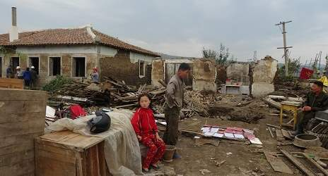 Devastated residents as their home was totally destroyed. Taken on early September: International Federation of Red Cross and Red Crescent Societies