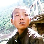 """A boy abandoned and lost home by his family due to extreme poverty.  He begged for food to the photographer.  He said, """"I live under the bridge.""""  June 2013, in a Northern part of Ryanggang Province.  Taken by our Team 'Mindeulle' (ASIA PRESS)"""