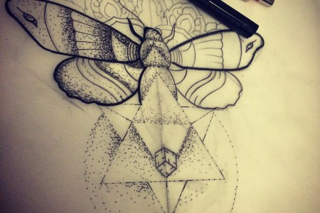 geometric moth tattoo design