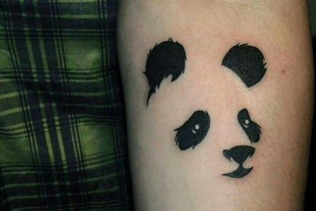 awesome panda cub face tattoo on forearm