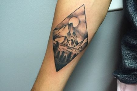 superb mountains and trees in diamond shape tattoo on forearm