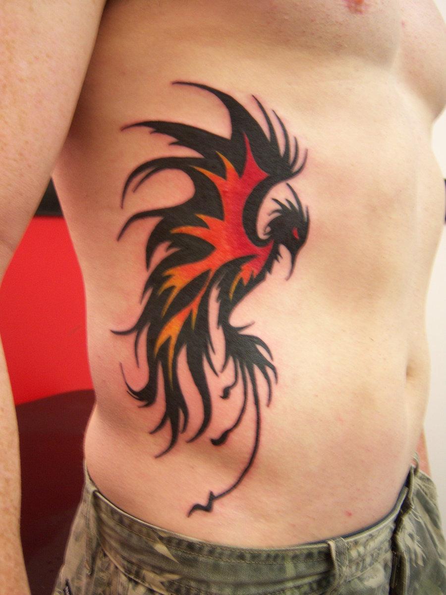 Black Tribal Flying Phoenix Tattoo On Man Side Rib - 2018 Tattoos Ideas
