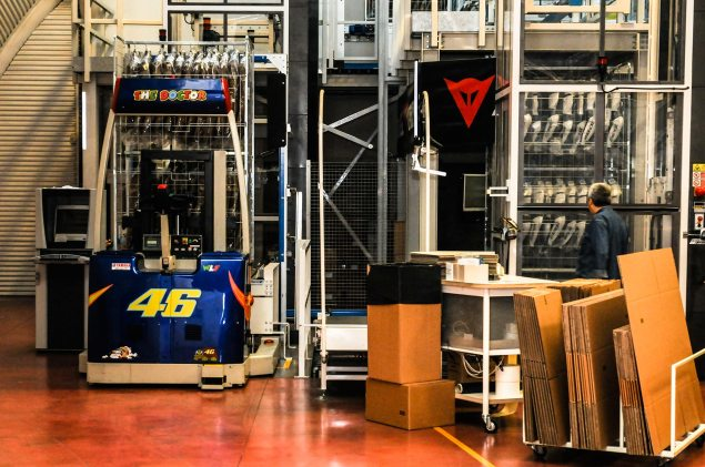 Factory Tour: Agostini vs. Rossi   Its Not What You Think Dainese Warehouse Rossi loading 635x421