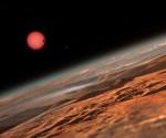 Ressam gözüyle kırmızı cüce çevresindeki bir gezegenin yüzeyi. Diğer gezegenlerden biri yıldızın önünden geçiş yaparken üçüncüsü yarı evresnde parlıyor (ESO/M. Kornmesser).