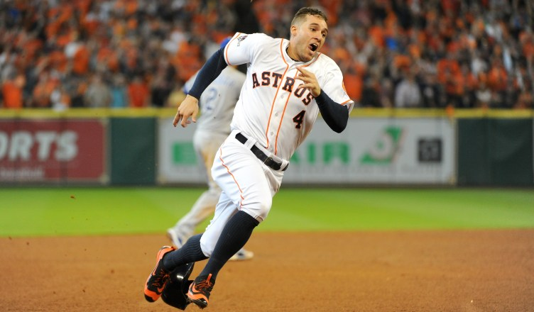 HOUSTON, TX - OCTOBER 12:  George Springer #4 of the Houston Astros rounds the bases to score the go ahead run on an RBI double in the fifth inning against the Kansas City Royals during game four of the American League Divison Series at Minute Maid Park on October 12, 2015 in Houston, Texas.  (Photo by Eric Christian Smith/Getty Images)