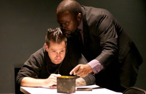 Ariel (Daviorr Snipes) grills Tupolski (Ian Gaenssley) over the gruesome contents of the box.