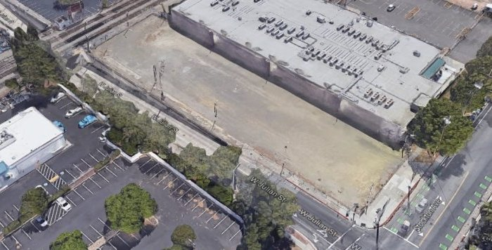 A vacant lot at the corner of West Julian Street and Stockton Avenue that was purchased on Jan. 16 for $4 million, in an elevated view. Realty investors have grabbed a downtown San Jose property that's expected to be developed as a high-rise hotel, a lodging site that would sprout next to a planned Google transit village.  Google Maps