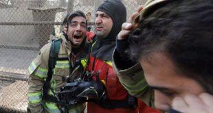 75名消防员罹难 (Photo credit should read STR/AFP/Getty Images)