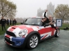 The record for most people crammed in a modern MINI is 28 using the MINI Hatch is achieved by Dani Maynard and her team in 18 minutes, at Potters Field, London in celebration of the eighth annual Guinness World Records Day, which is today. PRESS ASSOCIATION Photo. Picture date: Thursday November 15, 2012. Every year Guinness World Records Day captures the imagination of people young and old, from every side of the world to attempt some truly amazing and awe inspiring feats, from the bonkers to the brilliant nothing encapsulates the snapshot of human endeavours quite like Guinness World Records. Photo credit should read: Matt Alexander/PA