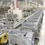 Eight-speed transmission housings prepare to move down the assembly line at Chrysler Group's Kokomo Transmission Plant.