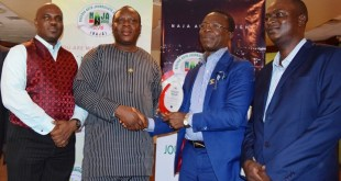 Commissioner for Transportation, Lagos State, Prince Anofi Elegushi (second left), presenting the  Automobile Personality of the Year award to the President, Coscharis Group, Dr. Cosmas Maduka, at the 2016 NAJA Awards. With them are the General Manager, Marketing and Corporate Services, Coscharis Group, Mr. Abiona Babarinde (left)  and the Chairman, NAJA, Frank Kintum.