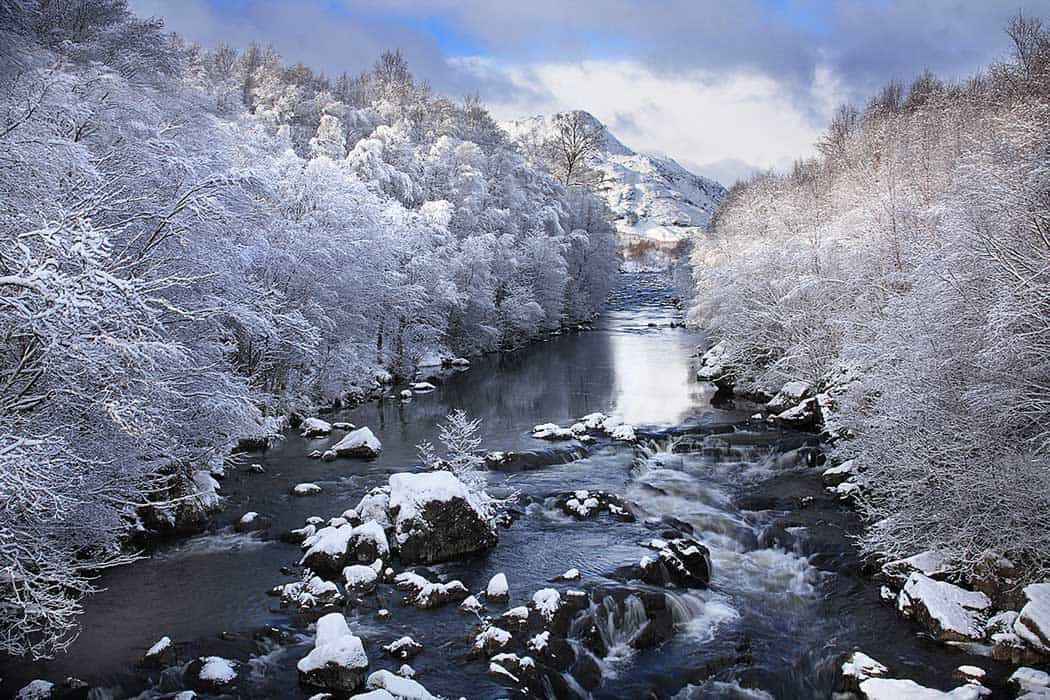The Claunie river in Winter after a snow fall. Click through to see 28 mind blowing photos of Scotland!