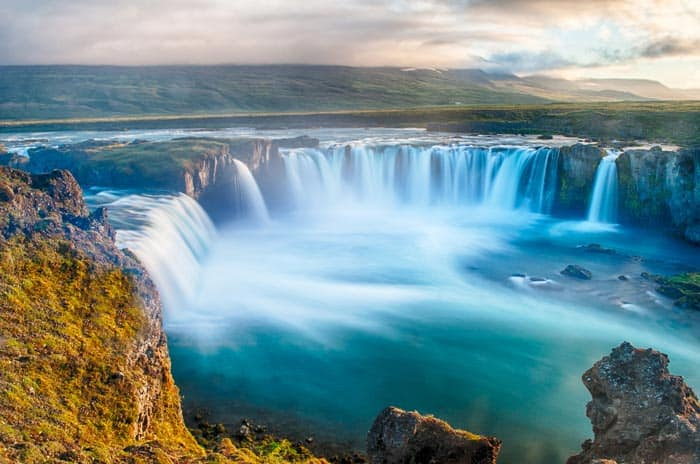 Godafoss waterfall is a one of a kind Icelandic waterfall. It is located on the north side of the island not far from the Lake Myvatn and the ring road. Click through to check out 15 of Iceland's BEST waterfalls!