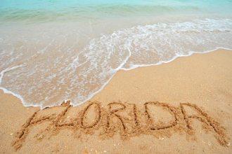 111bigstock-Florida-Written-In-Sand-33530381