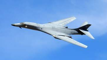 INDIAN SPRINGS AIR FORCE AUXILIARY FIELD, Nev. - A B-1 Lancer performs a fly-by during a firepower demonstration here recently.  The bomber is from the 7th Bomb Wing at Dyess Air Force Base, Texas.  (U.S. Air Force photo by Master Sgt. Robert W. Valenca)