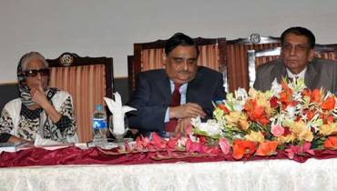 Dr. Asim Hussain with others