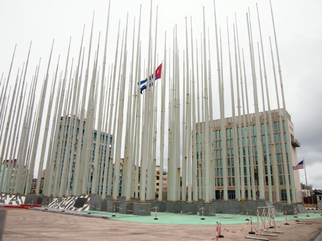 Flag poles remain in front of US Embassy
