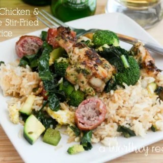 Our Grilled Chicken & Sausage Stir-Fried Rice might just make regular stir-fry obsolete. Why? For starters this one has smoked bratwurst sausage and mini-chicken drummies with our super fresh Garden Herb Chimmichurri! Get through to get this easy stir-fry recipe!