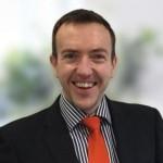 Neil wearing an orange tie