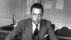 "Albert Camus (1913-1960) ecrivain ( prix Nobel de litterature en1957), journaliste redacteur en chef du journal Combat de 1944 a 1947 ici dans son bureau a ""Combat"" en 1945    --- Albert Camus (1913-1960) french writer here in 1945 in in office at paper ""Combat"""
