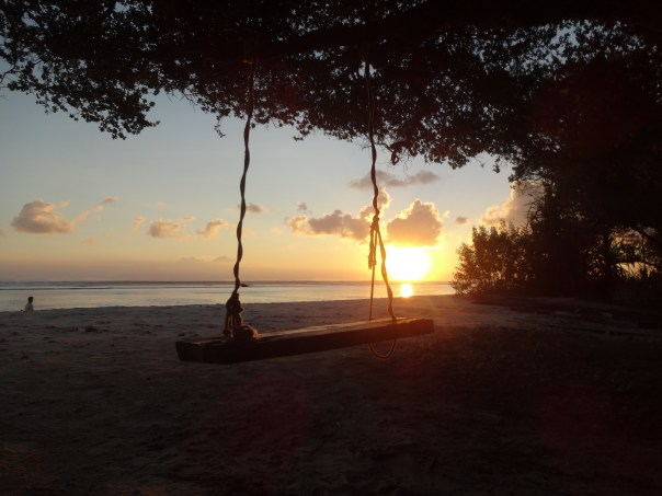 Swinging life away during sunset (Gili T, Indonesia, 2016).