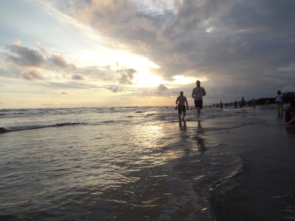 Pat and Chris walking down the beach (Indonesia, 2016).