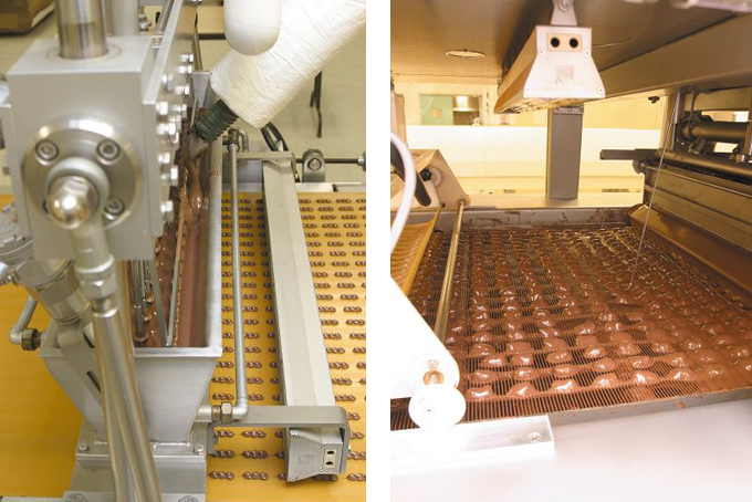 Chocolate is being placed onto of the macadamia nuts