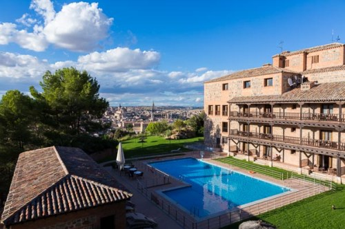 Parador de Toledo with swimming pool and dramatic overview of the city of Toledo, Spain, Europe