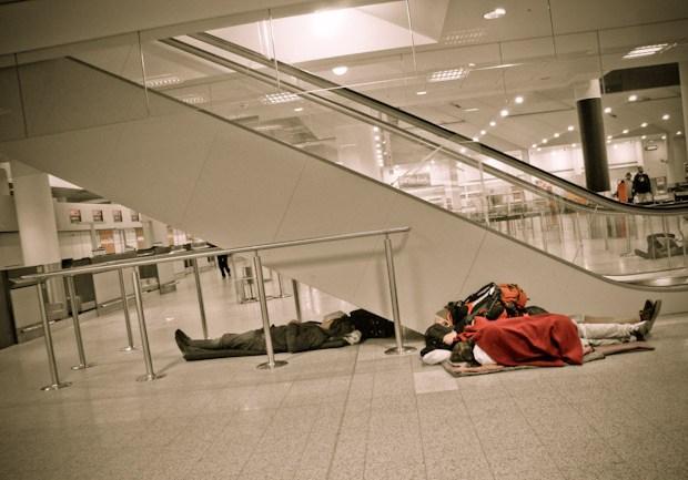 sleeping in airport by escalator