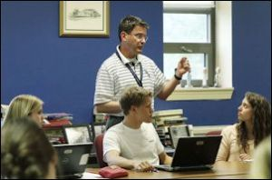 Rob Peck teaches advanced placement U.S. government class at Douglas Freeman. Photo credit: Richmond Times-Dispatch.