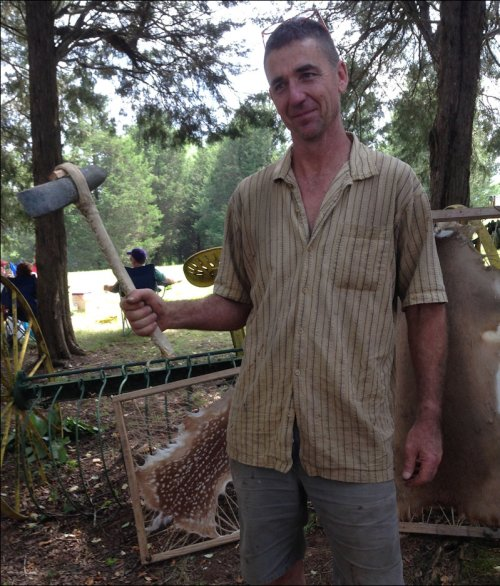 Kevin Baker's passion is re-creating ancient artifacts like the stone axe he's holding here. Working in his spare time, he also makes stone knives, custom bows & arrows, and turkey calls -- when he's not building tree houses or doing historic renovations.