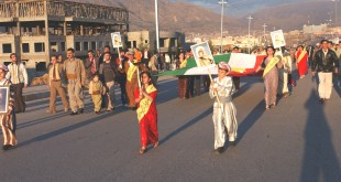 Kurdish residents march in the Kurdish New Year Parade. Photo by Army Sgt. Dennis Gravelle, 138th MPAD.