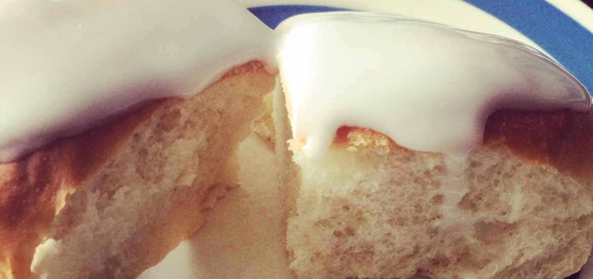 Using a metal spoon, thickly drizzle the icing over each bun.