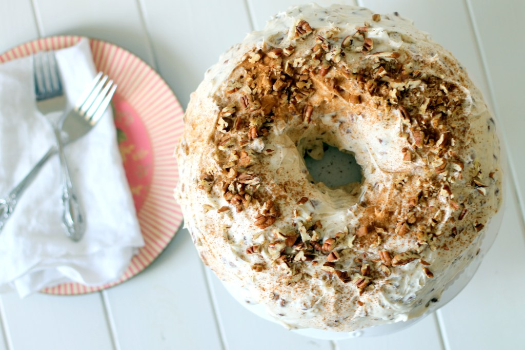 This moist, easy Carrot Cake with Pecan Cream Cheese Frosting comes together quickly and is topped with a super creamy, pecan-studded cream cheese frosting!