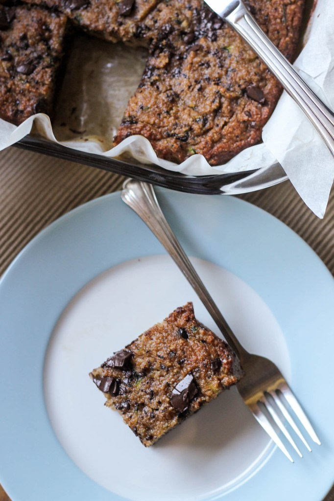 This Chocolate Chunk Zucchini Bread is perfectly sweet and tender without all the grains and sugar of traditional zucchini bread! It is Paleo friendly, gluten-free, grain-free, and refined sugar-free.