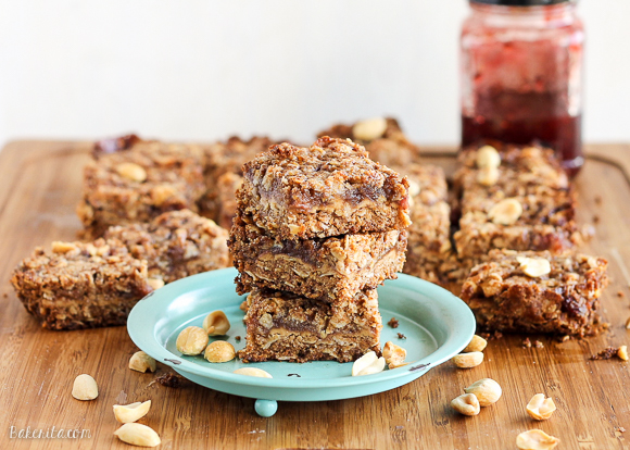 These Peanut Butter & Jelly Crumb Bars have a layer of PB&J in the middle, surrounded by a crunchy oatmeal crust. The bars are gluten-free, vegan, and refined sugar-free.