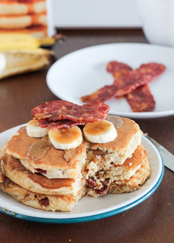 These Elvis Pancakes are banana peanut butter pancakes stuffed with peanut butter and bacon. These are the ultimate breakfast treat - made with only 4 ingredients!