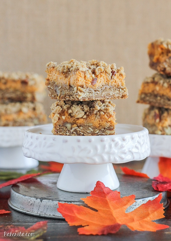 These Pumpkin Cheesecake Crumb Bars have a crumble crust full of oats and pecans with a creamy pumpkin cheesecake filling. This recipe is an irresistible fall treat!