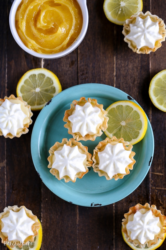 These Lemon Cream Pie Bites may be tiny, but they're bursting with bright lemon flavor. Lemon curd and whipped cream are the stars of these bite-sized pies - no baking required!