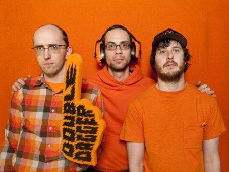 Double Dagger in their signature orange (L to R): Nolen Strals, vocals; Bruce Willen, bass; Denny Bowen, drums. Photo by Bruce Willen.