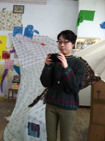 Curator Hyejung Jang documents her artists work in the sunny School 33 space they share.