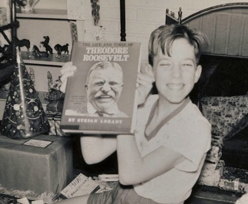 Marc at age 12 with book about his hero Teddy Roosevelt.