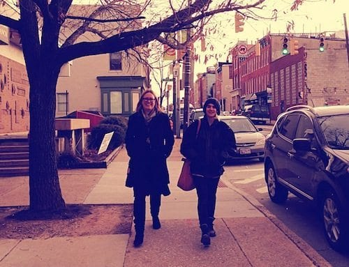 Beth Fredrick and Elisa Garcia de la Huerta stroll toward School 33 in Federal Hill.