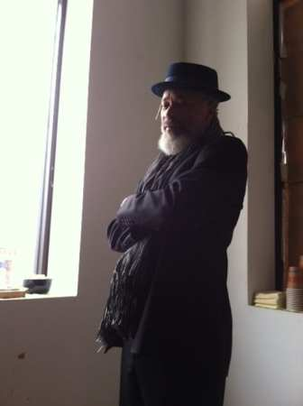 Don Palmer visits Garcia de la Huerta's workspace.