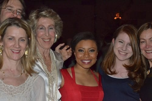 BSA grad Shalita Grant (red dress) along with friends and castmates from the play. Photo by Brent Moore.