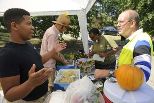High school students, like Gary Brown, work alongside Jason at community events to bring healthful food choices to Curtis Bay residents, and teach those who are interested the value in urban agriculture, outdoor spaces and community gardening.