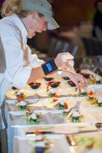 The Schola team preps a course at Passion for Food & Wine in 2015