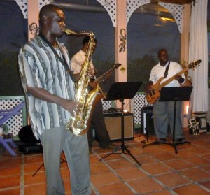Mylon Clarke entertains at a BJS member's mingle. Along with Mylon is Darrin Massiah on guitar & Lorin Jackson on bass. July 2012