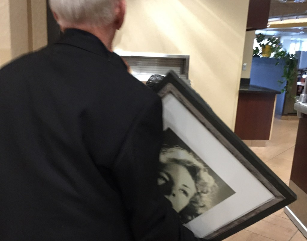 dad carrying mom's portrait